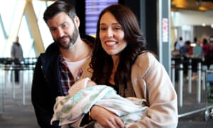 Ardern arrives with Neve, her newborn daughter, and Clarke Gayford at Wellington Airport.