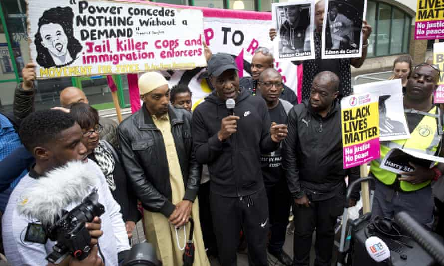 Rashan Charles's father Esa, third left, with shadow home secretary Diane Abbott, second left, at a vigil for Charles.