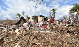 Residents in Les Cayes survey the wreckage of homes destroyed by Hurricane Matthew which left at least 1.4 million people needing emergency aid.