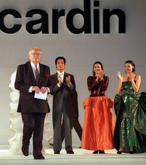 Cardin appears on the catwalk as models clap at the end of a show in Ho Chi Minh City, Vietnam, in 1999