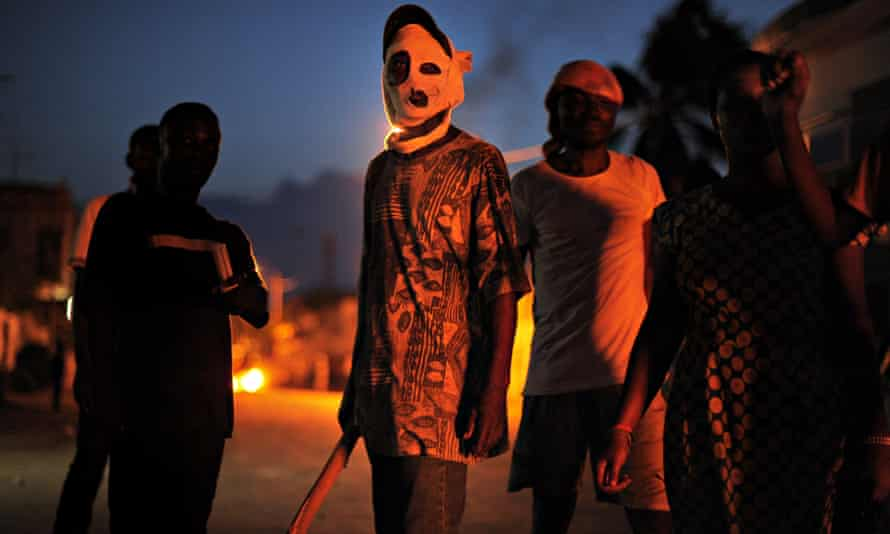 A masked anti-government protester is seen during clashes with police in Lomé in 2013