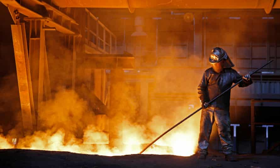 A worker processes liquid steel at the ArcelorMittal factory.