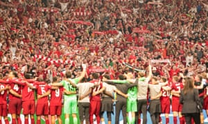 """Liverpool players and fans sing """"You'll Never Walk Alone."""""""