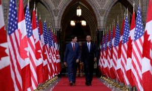 Canada's Justin Trudeau and Obama walk in on parliament hill in Ottawa on 29 June 29.