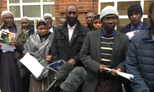 Families of of the five workers who died in July 2016 outside Birmingham coroner's court on Friday