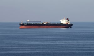 Oil tankers pass through the strait of Hormuz. Despite tensions in the Gulf oil's price has slided.