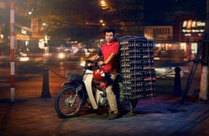 A delivery driver on a motorbike in Hanoi, Vietnam, carrying eggs
