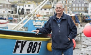 Rod Ingram in front of his boat Petrel, in Mevagissey.