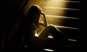 VARIOUSMandatory Credit: Photo by Design Pics Inc/REX (757234a) Depressed girl in stairwell with light streaming in