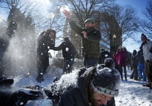 People have a snowball fight at Dupont Circle in Washington, DC