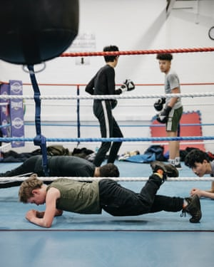 Young people work out in the ring.
