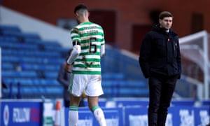 Celtic's Nir Bitton walks past Rangers manager Steven Gerrard (right) after being sent off.