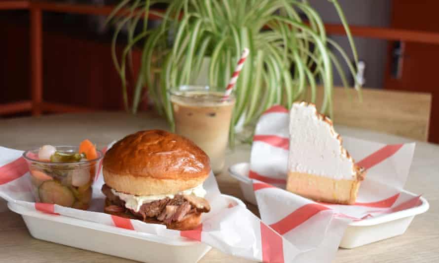 salt beef and cream cheese bun in takeaway box