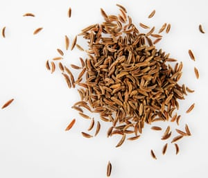 Caraway seeds on white background
