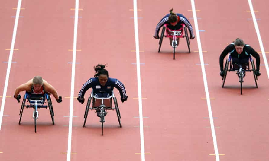 Anne Wafula Strike, second left, races in the women's 100m T54 final during the Visa London Disability Athletics Challenge in May 2012, one of the test events before London's hosting of the Olympic Games.