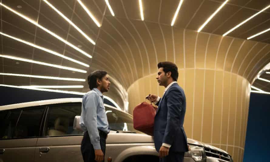 Adarsh Gourav (Balram) and Rajkummar Rao (Ashok) in The White Tiger.