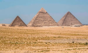 The Great Pyramid of Khufu (Cheops), the Pyramid of Khafre (Chephren), and the Pyramid of Menkaure (Menkheres) at the Giza Pyramids necropolis on the outskirts of Cairo