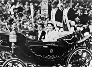 Crown Prince Akihito and Crown Princess Michiko parade after their royal wedding in Tokyo in April 1959
