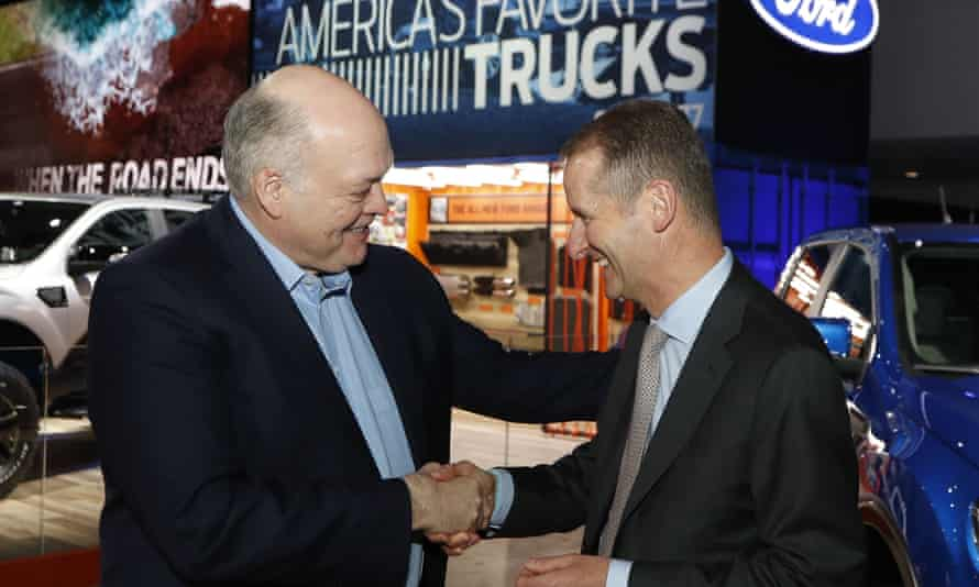 Ford's CEO, Jim Hackett, left, meets Herbert Diess, CEO of Volkswagen, on Monday in Detroit.