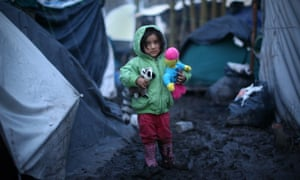 A young Kurdish girl at a new refugee camp in Dunkirk