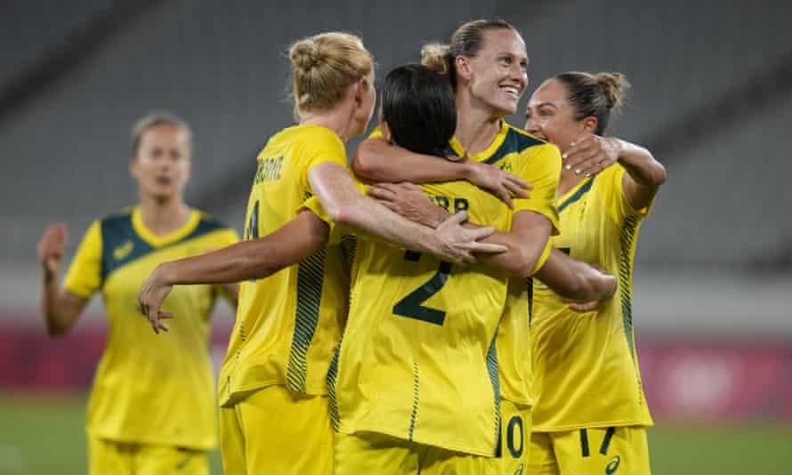 Matildas skipper Sam Kerr celebrates with teammates after her goal against New Zealand.