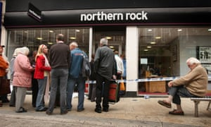 Customers wait in line to remove their savings from a branch of The Northern Rock bank on 17 September, 2007 in Kingston-Upon-Thames, England.