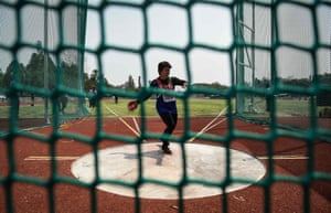 A woman in the 65-70 age category competing in the discus