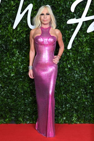 Donatella Versace, wearing a metallic pink gown, accepted the awards for British designer of the year (menswear) on behalf of Kim Jones for Dior
