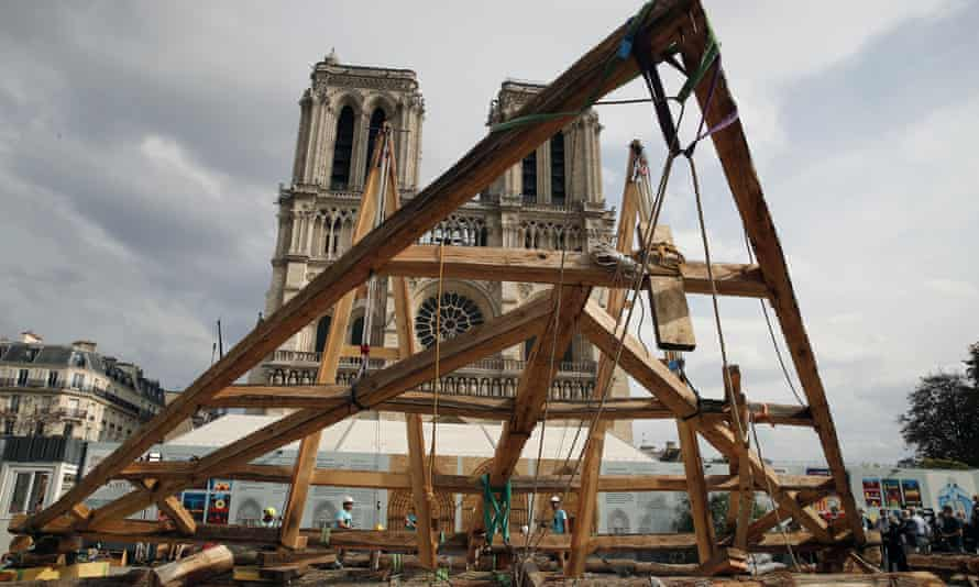 Carpenters put the skills of their Medieval colleagues on show on the plaza in front of Notre Dame Cathedral in Paris, France, Saturday, Sept. 19, 2020. Last July, Macron announced the spire would be reconstructed exactly as it was.