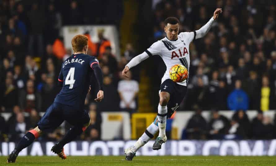 Tottenham Hotspur's Dele Alli controls the ball despite the challenge of Newcastle United's Jack Colback.