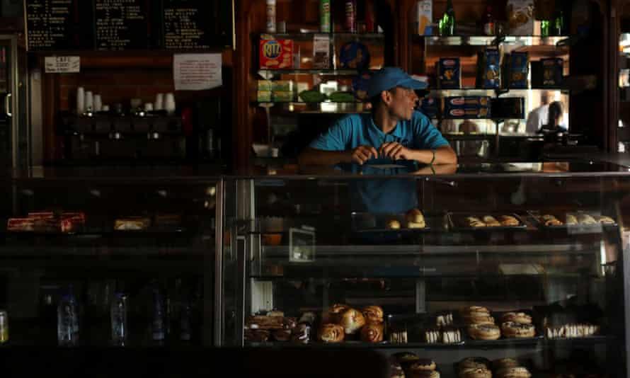 A worker inside a bakery.