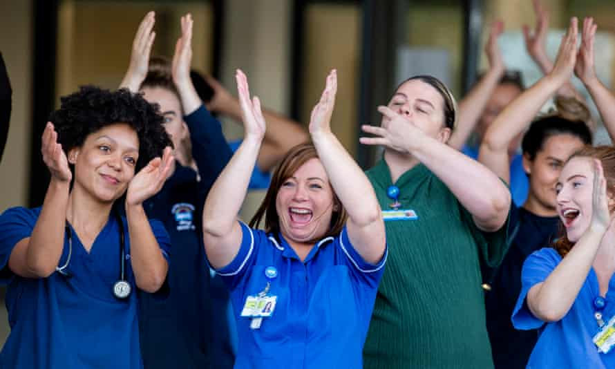 NHS staff at Aintree university hospital in Liverpool, UK, on the night of the final Clap for Carers, on 28 May.