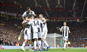 Paulo Dybala is mobbed by his Juventus teammates after scoring the crucial goal in a one-sided Champions League win at Manchester United.