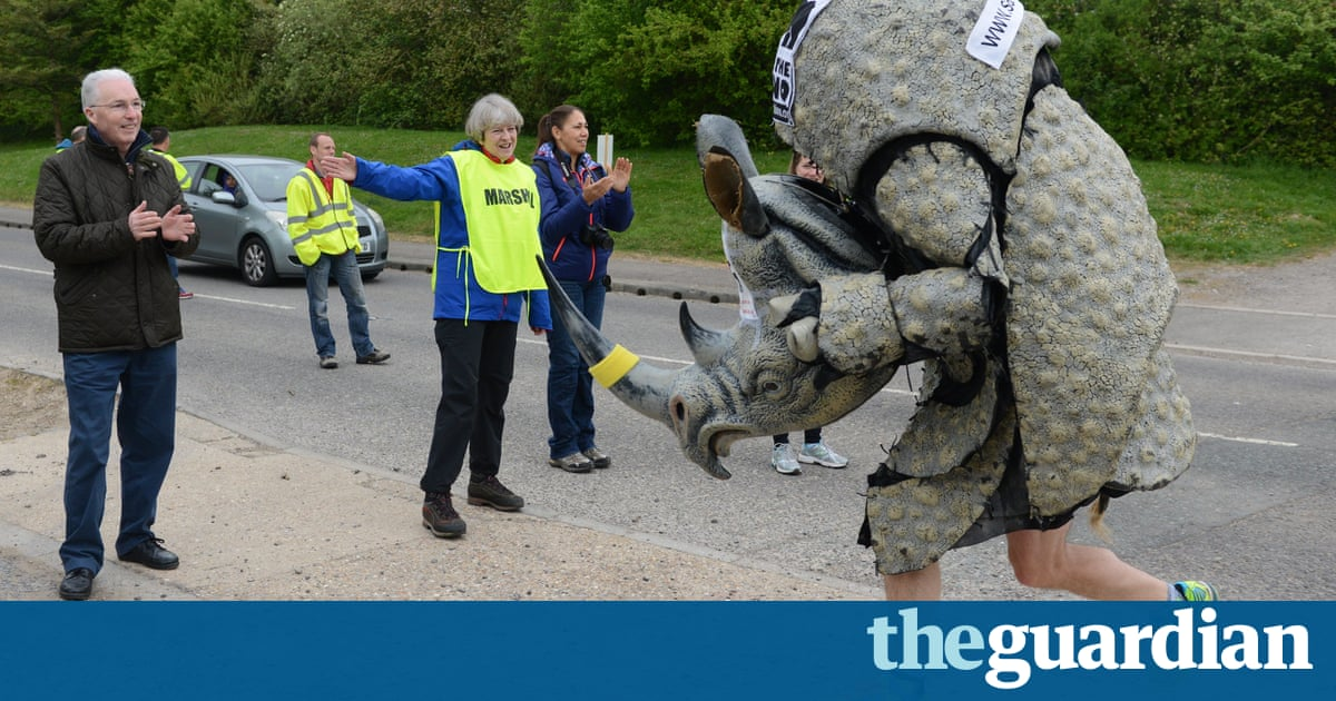 Marshall law: Theresa May dons hi-vis vest to help out at race