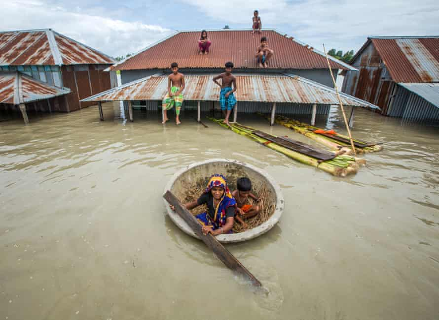 Bangladeshis escape floods in a makeshift raft.