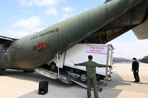 A truck carrying Covid-19 vaccines is loaded onto an Air Force airplane at Seoul Air Base in Seongnam, south of Seoul, on 19 February 2021, before it flies to Jeju airport on South Korea's largest island of the same name.