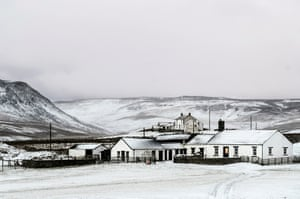 A farm house blanketed by overnight snow near Langdon Beck, as dawn breaks in the North Pennines