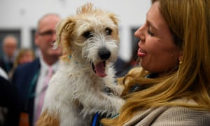Dilyn the dog being hugged by Carrie Symonds