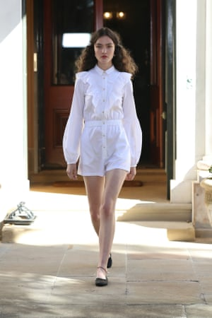 Wearing shorts to the office is do-able with a tailored romper like MacGraw's smart but sweet outfit.