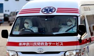 An ambulance can be seen at Daikoku Pier in Yokohama Japan where the Diamond Prince Cruise Ship stopped