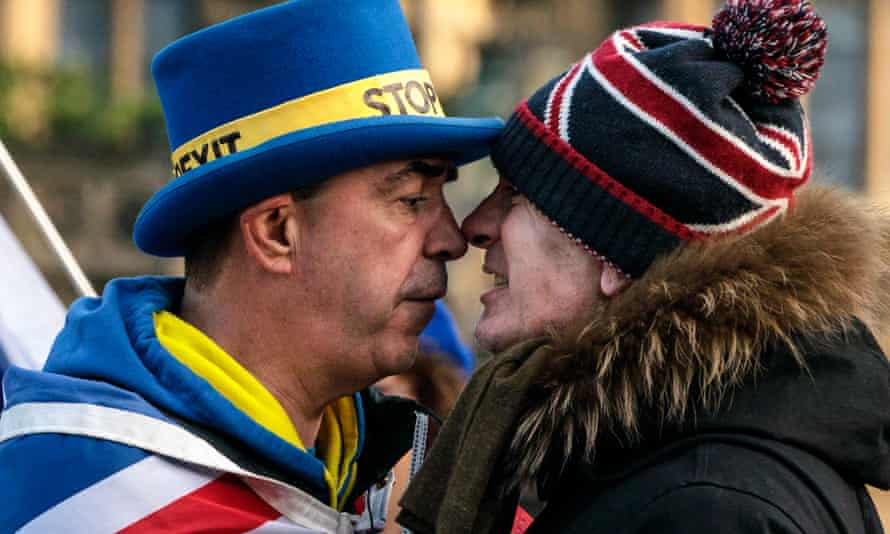 Main in 'stop Brexit' nose-to-nose with man in Union Jack bobble hat.