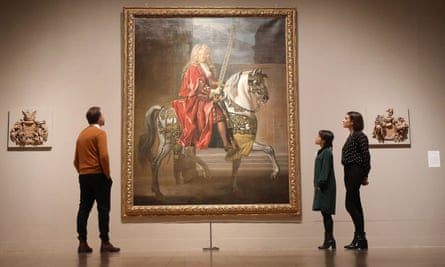 Visitors look at Equestrian Portrait of a Lord Mayor (c.1695-1705) by John Closterman, part of Tate Britain's British Baroque: Power and Illusionexhibition.