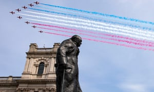 The Red Arrows fly over the statue of Churchill on 8 May 2020.