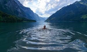 A swimmer in Klöntalersee, Glarus, Switzerland.