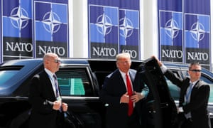 Donald Trump arrives at the Nato summit in Brussels, Belgium Wednesday.