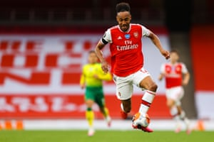 Arsenal's Pierre-Emerick Aubameyang controls the ball shoots and scores a goal.