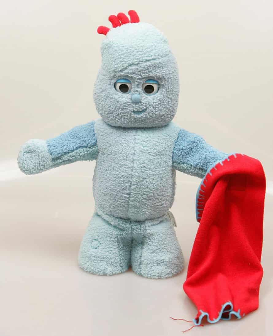 A cuddly toy version of Iggle Piggle, holding a red blanket