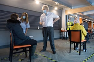 British prime minister Boris Johnson meets staff and patients at Barnet FC's ground, The Hive, which is being used as a coronavirus vaccination centre, in north London, Britain, on 25 January, 2021.