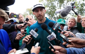 Pre-tournament favourite Dustin Johnson speaks with the media outside the clubhouse after withdrawing from the Masters due to injury just as he reached his tee time