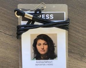 A press badge for Des Moines Register reporter Andrea Sahouri features her jail booking photo from her 31 May 2020 arrest.